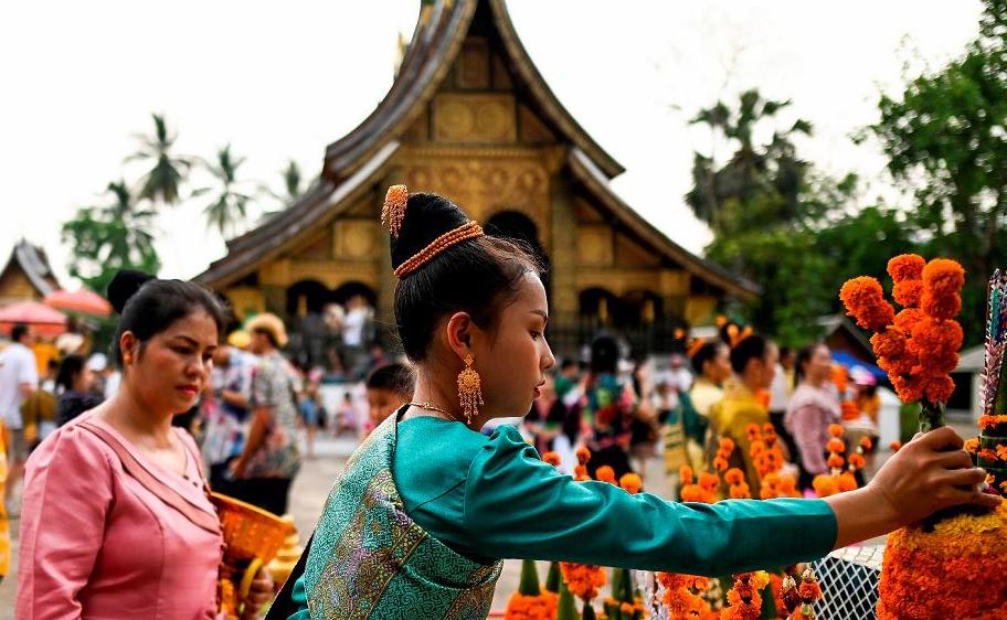 Celebração do ano novo tailandês, em Jinghong no sudoeste da província de Yunnan na China.
